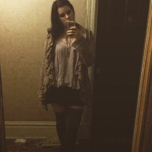 here, I'm wearing both one of my favorite cardigans as well as thigh-highs